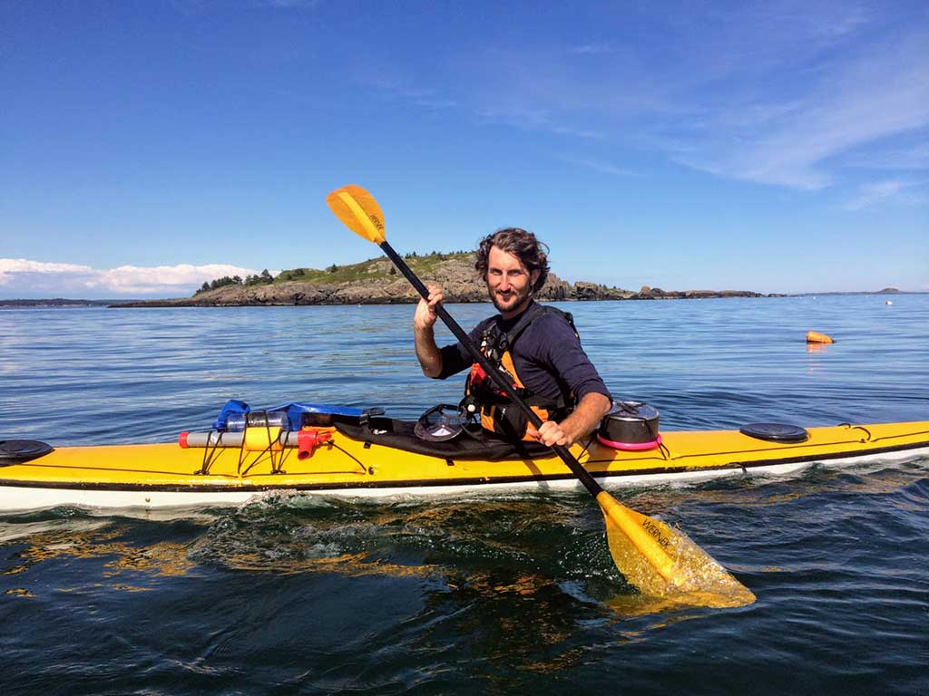West End News - Zack Anchors of Portland Paddle in kayak enjoying his outdoorsy city of Portland, ME